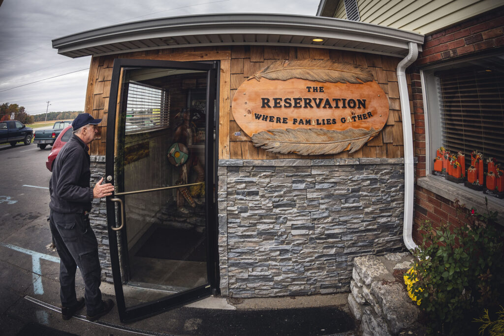 A man enters the front door of Chicken Trail member Reservation Restaurant in Milan, Indiana.