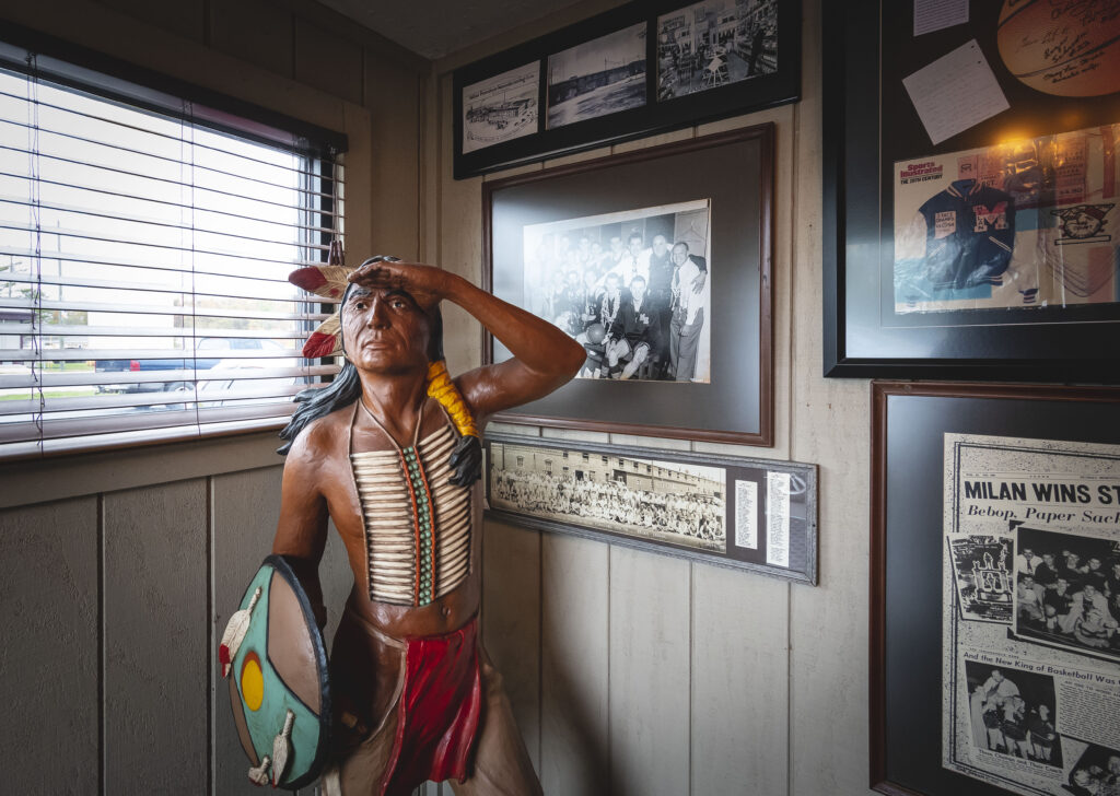 A wooden Indian and pictures on the wall in the entrance of the Reservation Restaurant.