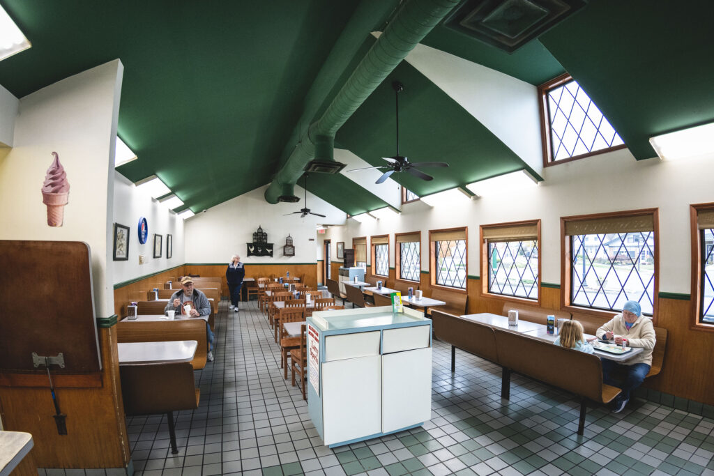 Chicken Trail member Dairy Cottage interior showing a tile floor and a green painted ceiling.