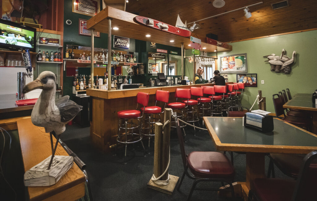 Bar area with red stools at Ainsley's Cafe.