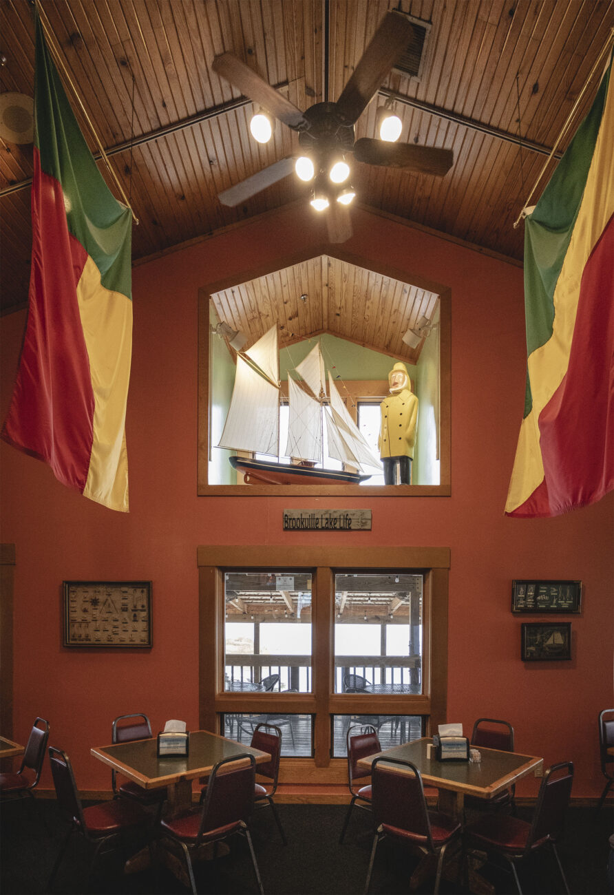 Interior view of Ainsley's Cafe showing nautical them and high ceilings.