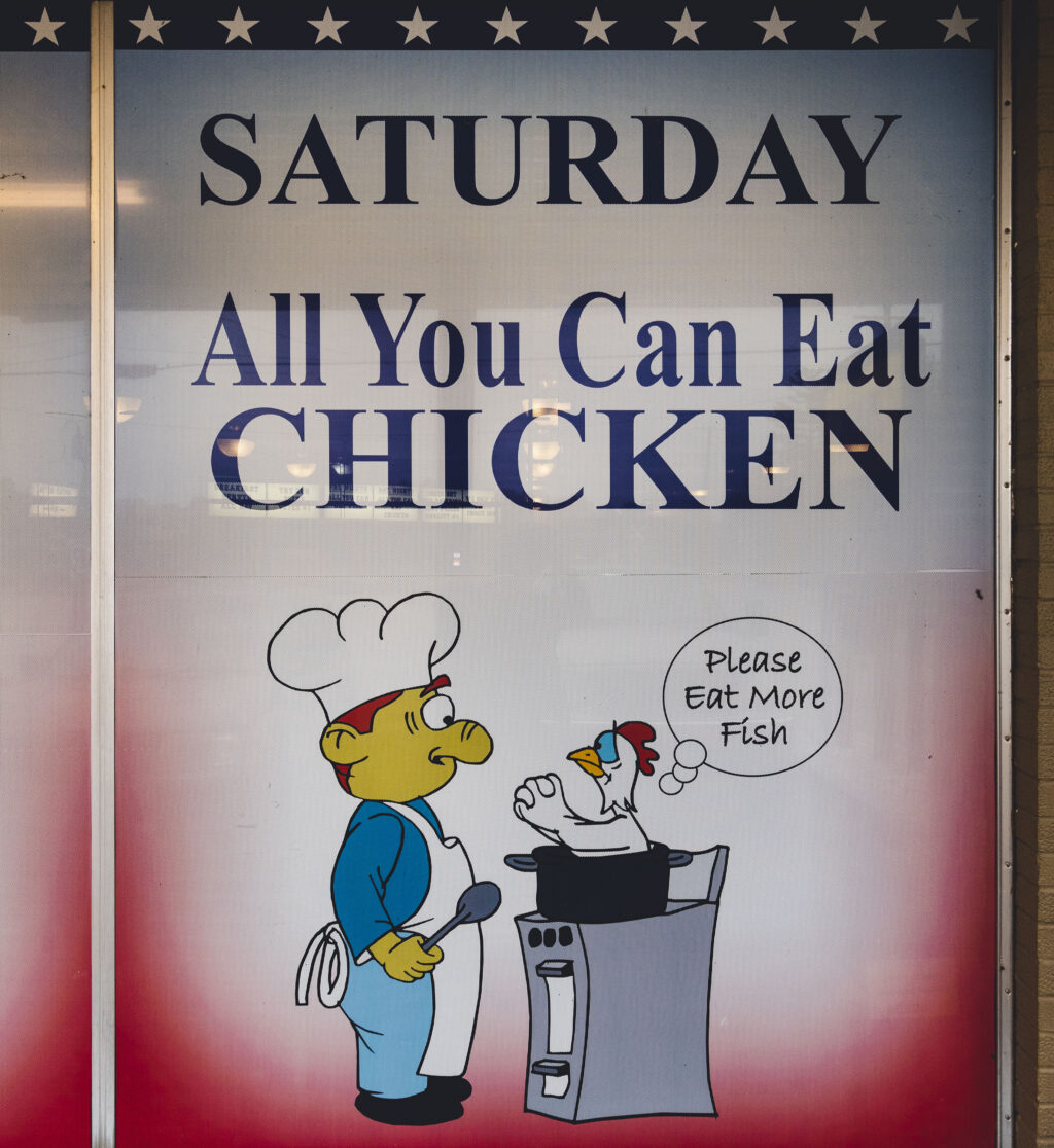 """Sign showing """"Saturday All You Can Eat Chicken"""" at Liberty Bell Family Restaurant."""