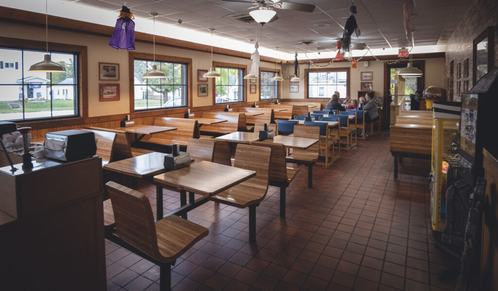 J's Dairy Inn interior showing red tile floor and wooden booths.