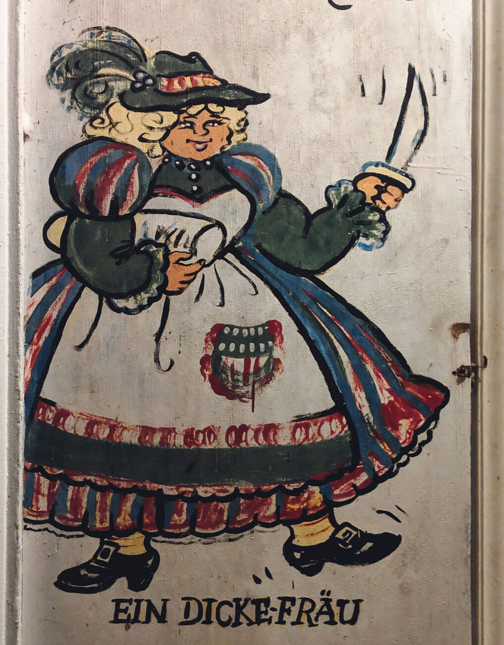 """Painting of """"ein dicke Frau,"""" or thick wife outside the Brau Haus in Oldenburg, Indiana."""
