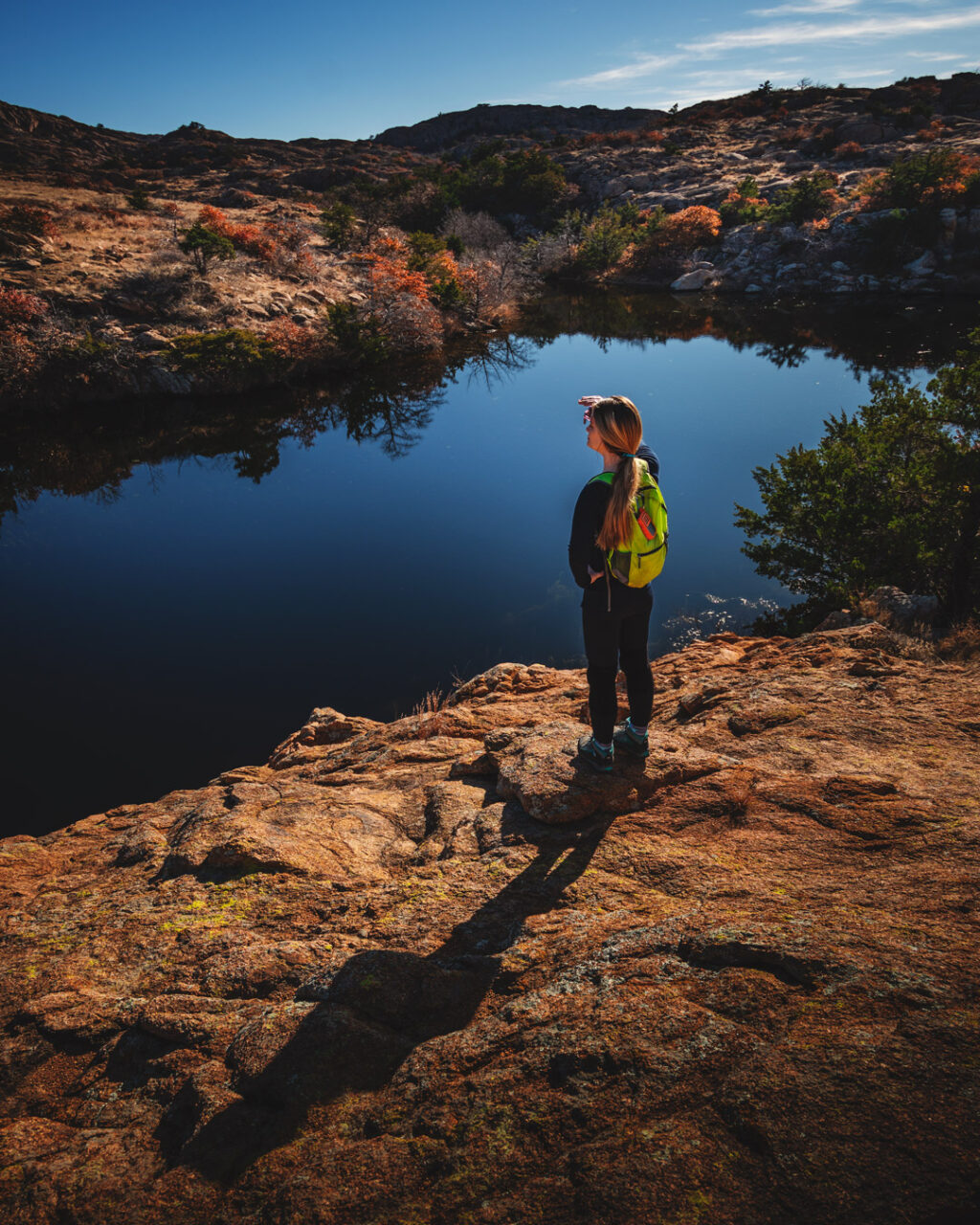 Woman hiker overlooking Treasure Lake off Charon's Garden Trail in the Wichita Mountains Wildlife Refuge in Oklahoma.