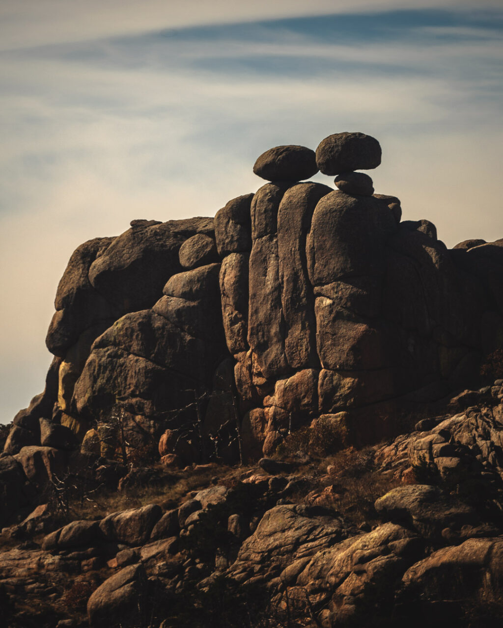 Rock formation known as Crab Eyes with two precariously-balanced boulders atop a rocky outcropping that resembles crab eyes.