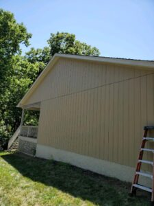 Houston Remodeling Services replacing damaged siding after