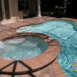 Round Spa and Pool in Backyard