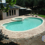 Kidney Shaped Inground Pool with Round Spa