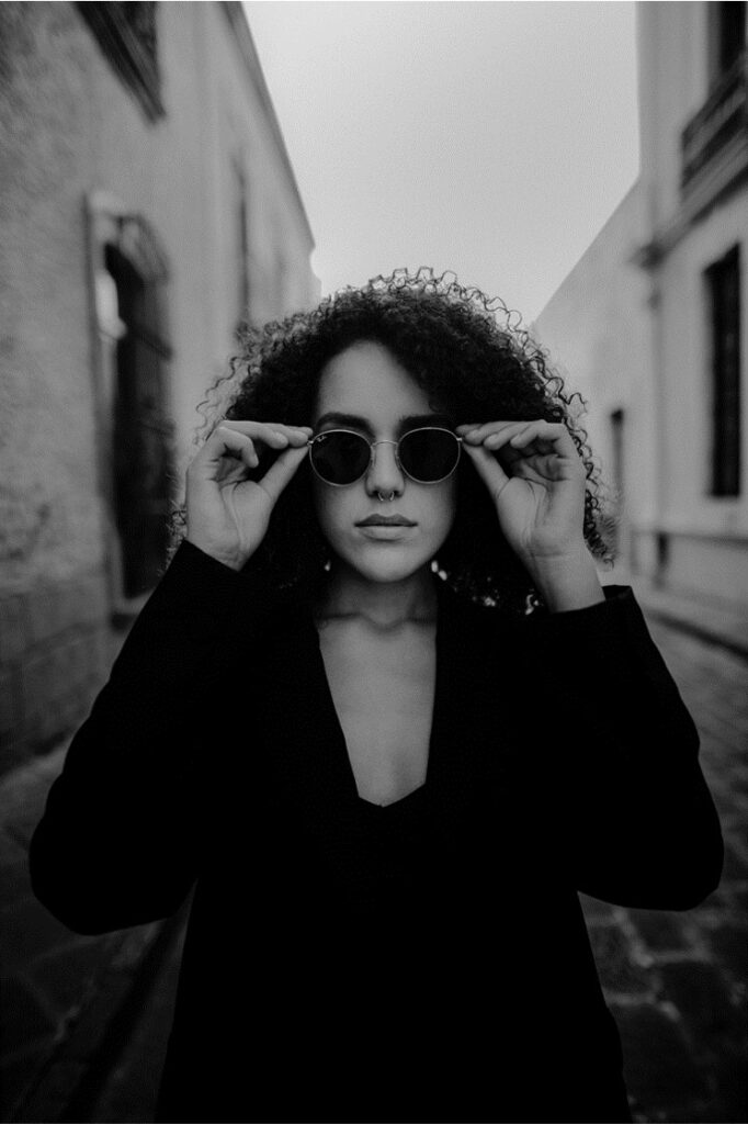 Story Seeds Prompt: The Woman in Sunglasses