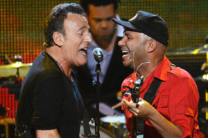 Bruce Springsteen and Tom Morello are direct descendants of Seeger's folk tradition.