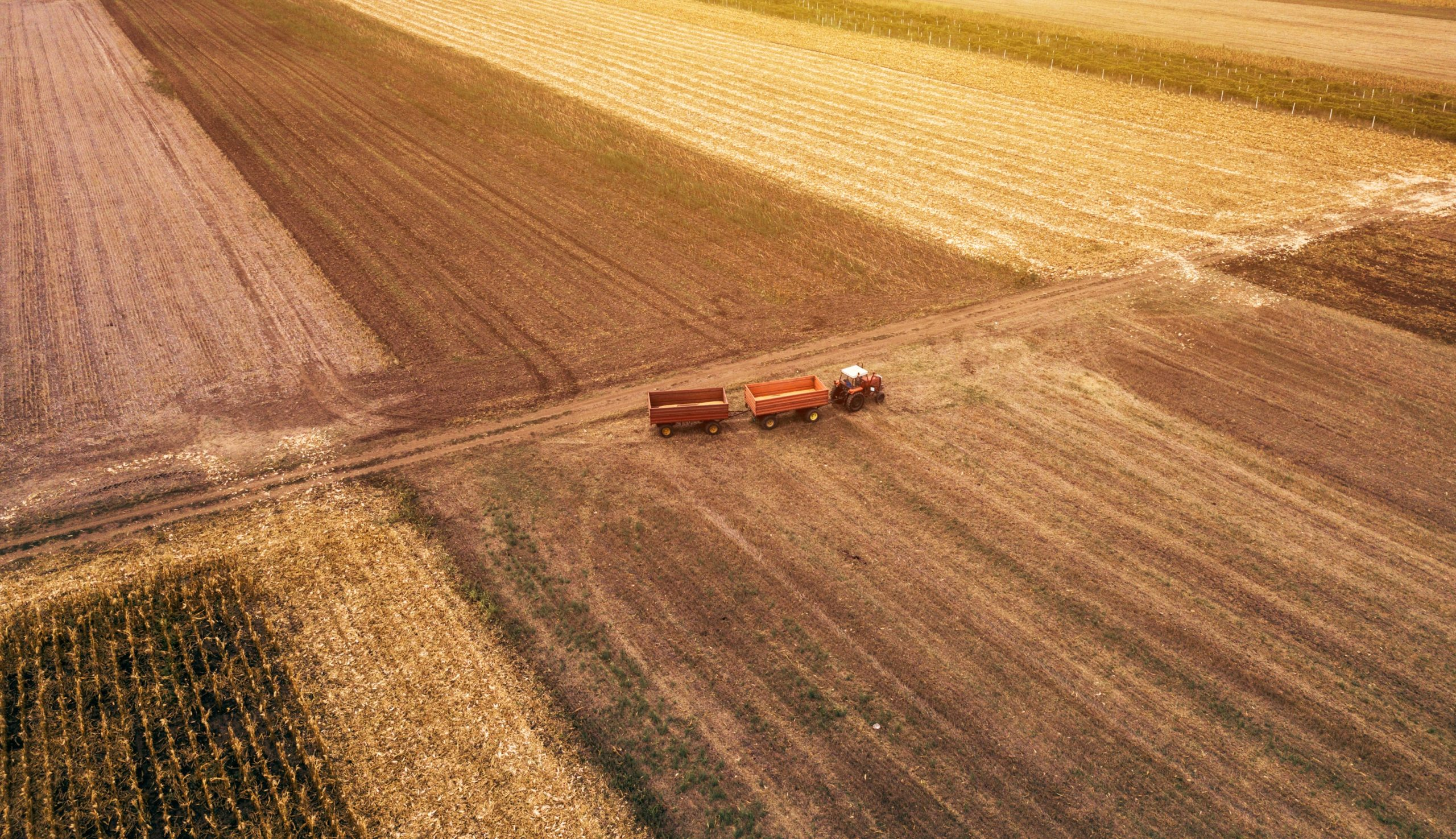aerial-view-of-agricultural-tractor-in-the-field-PQ92XKR-min