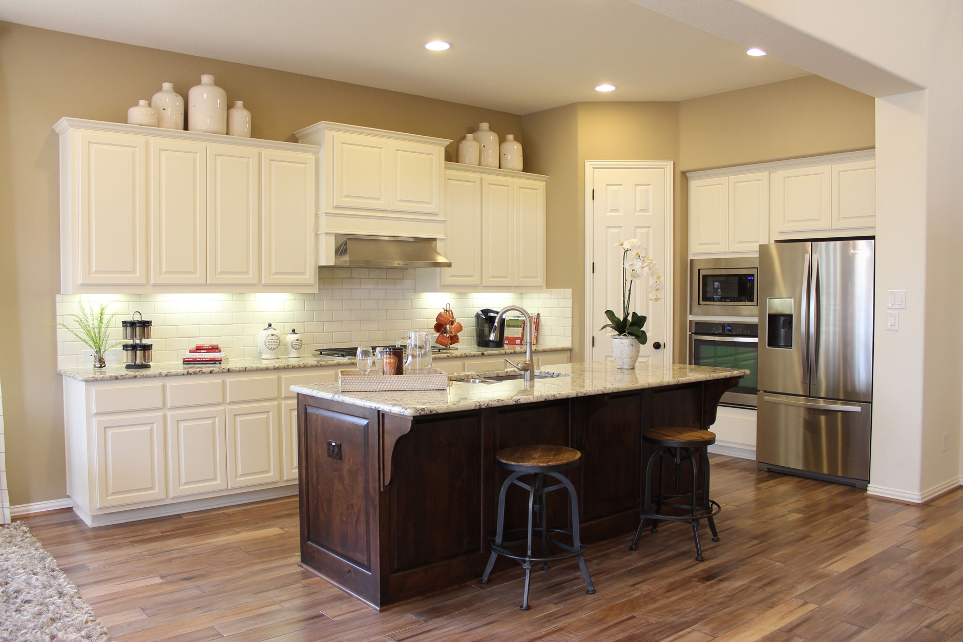 Burrows Cabinets kitchen in knotty alder and appliance end panels