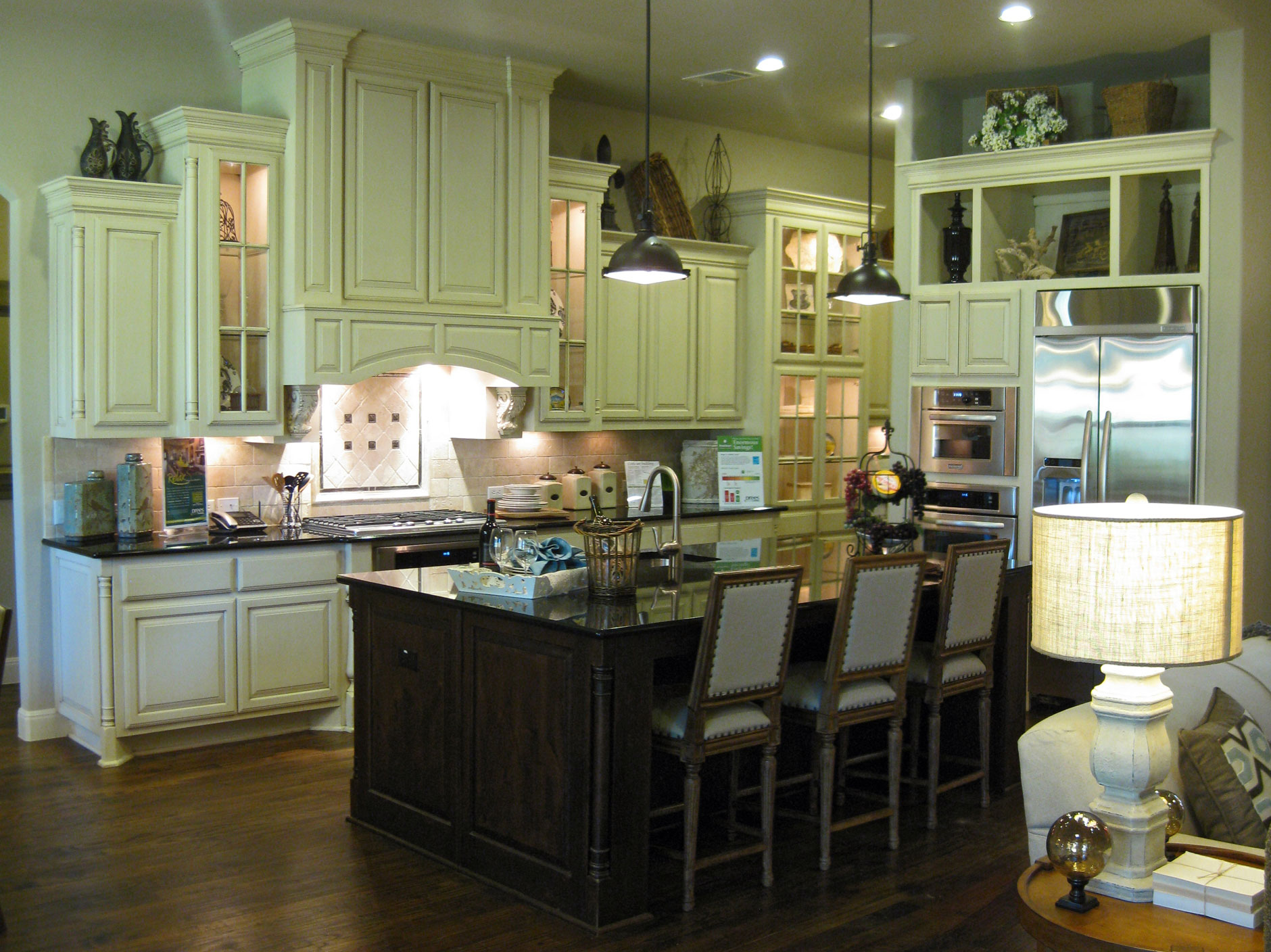 Burrows Cabinets kitchen cabinets with Elite vent hood in Bone with brown glaze