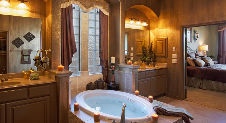 Master bathroom with center tub dividing vanities