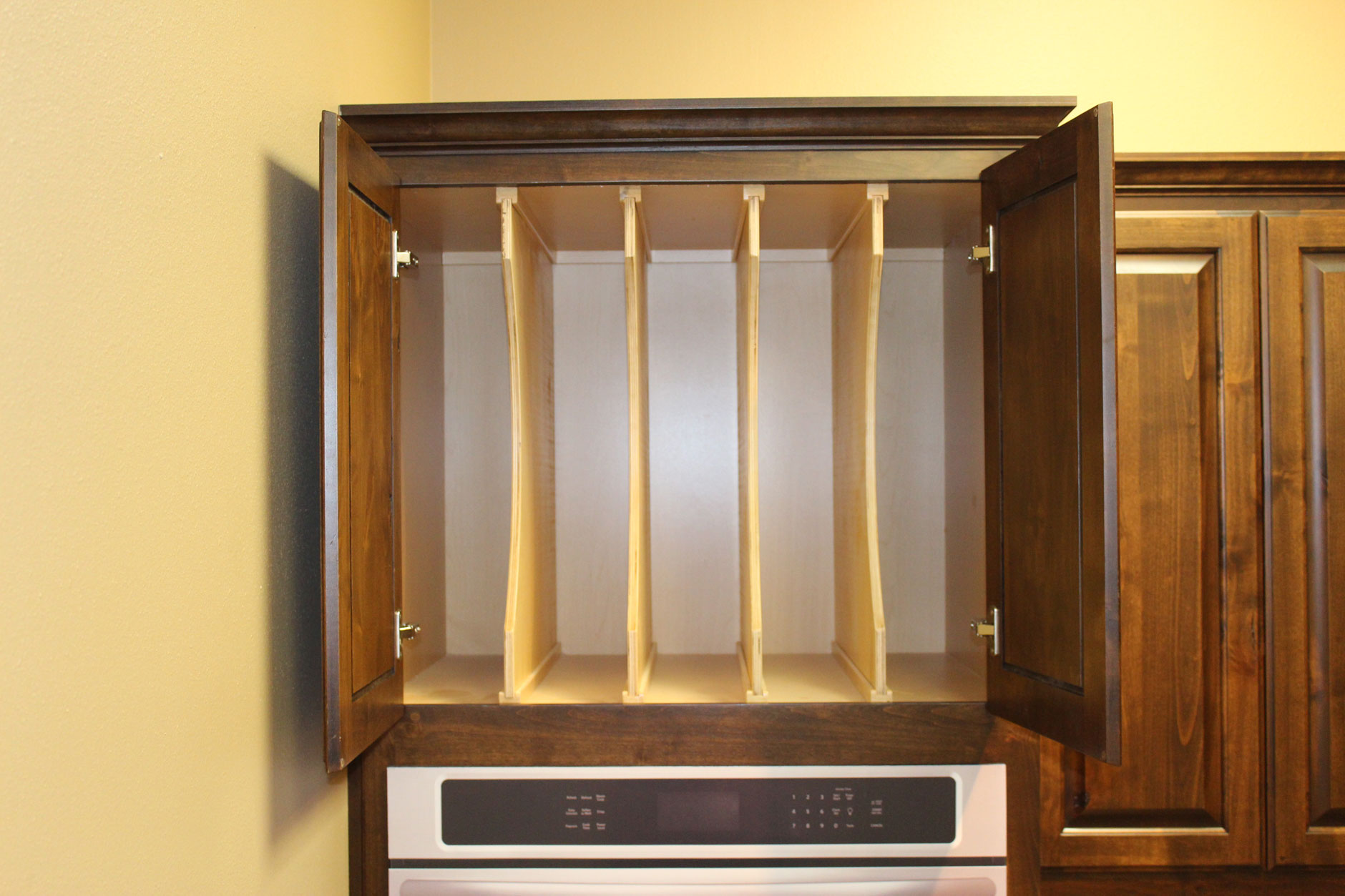 Cookie sheet and platter dividers for kitchen cabinets