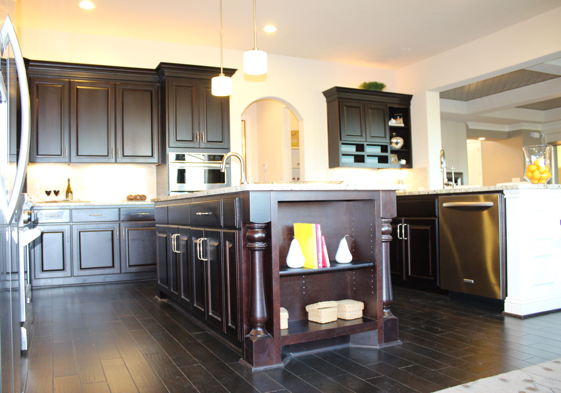 Kitchen island with monaco corner posts and open shelves in Espresso by Burrows Cabinets