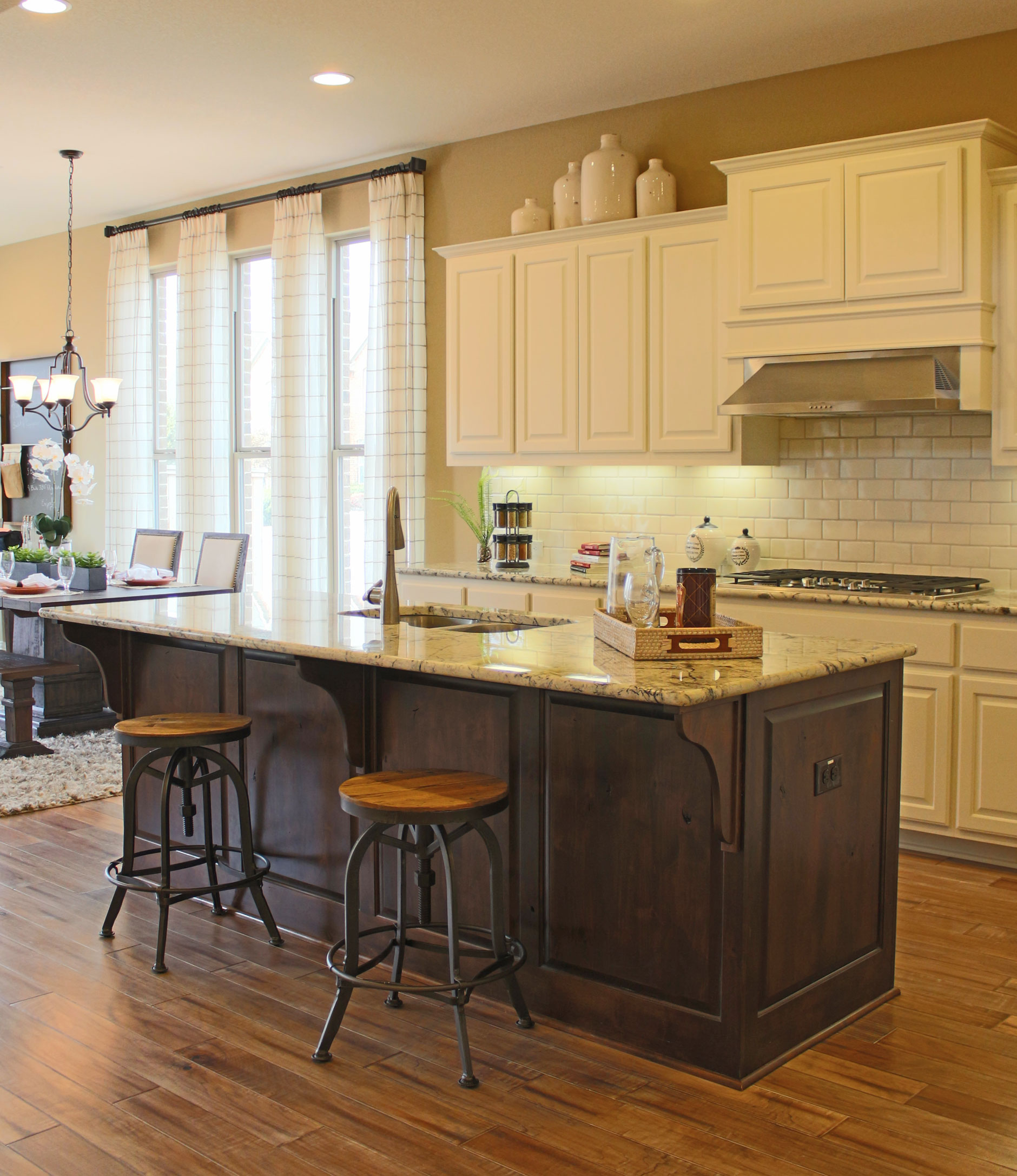 Kitchen island with corbels in knotty alder by Burrows Cabinets
