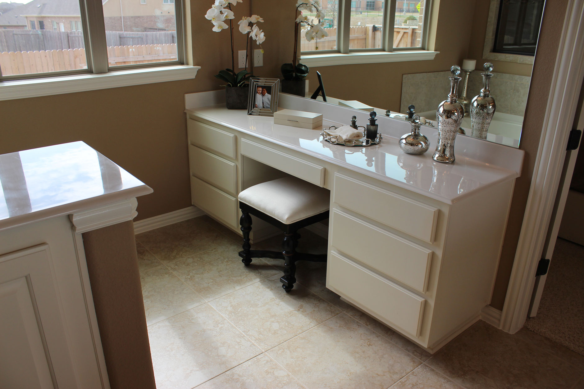 Burrows Cabinets master bath vanity with knee space in bone