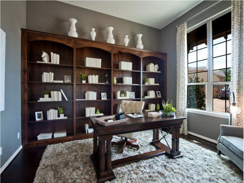 Study with built in knotty alder bookshelves by Burrows Cabinets