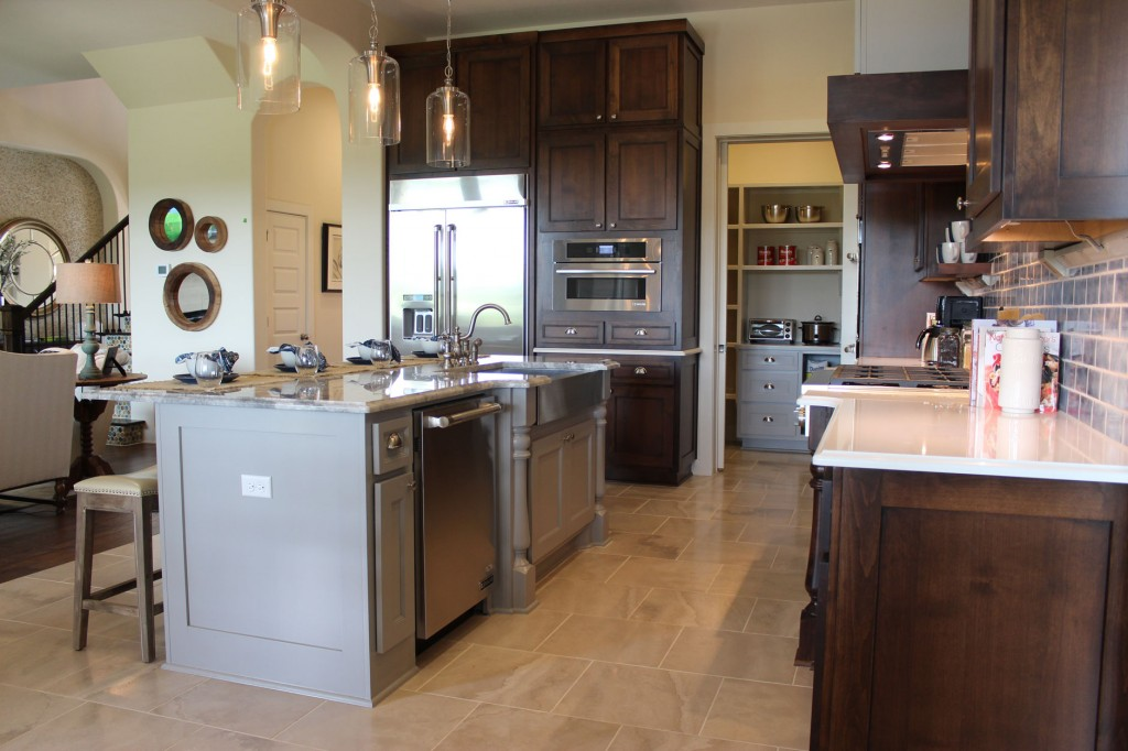Burrows Cabinets kitchen cabinet 17 with Terrazzo doors in stain and grey painted island with posts