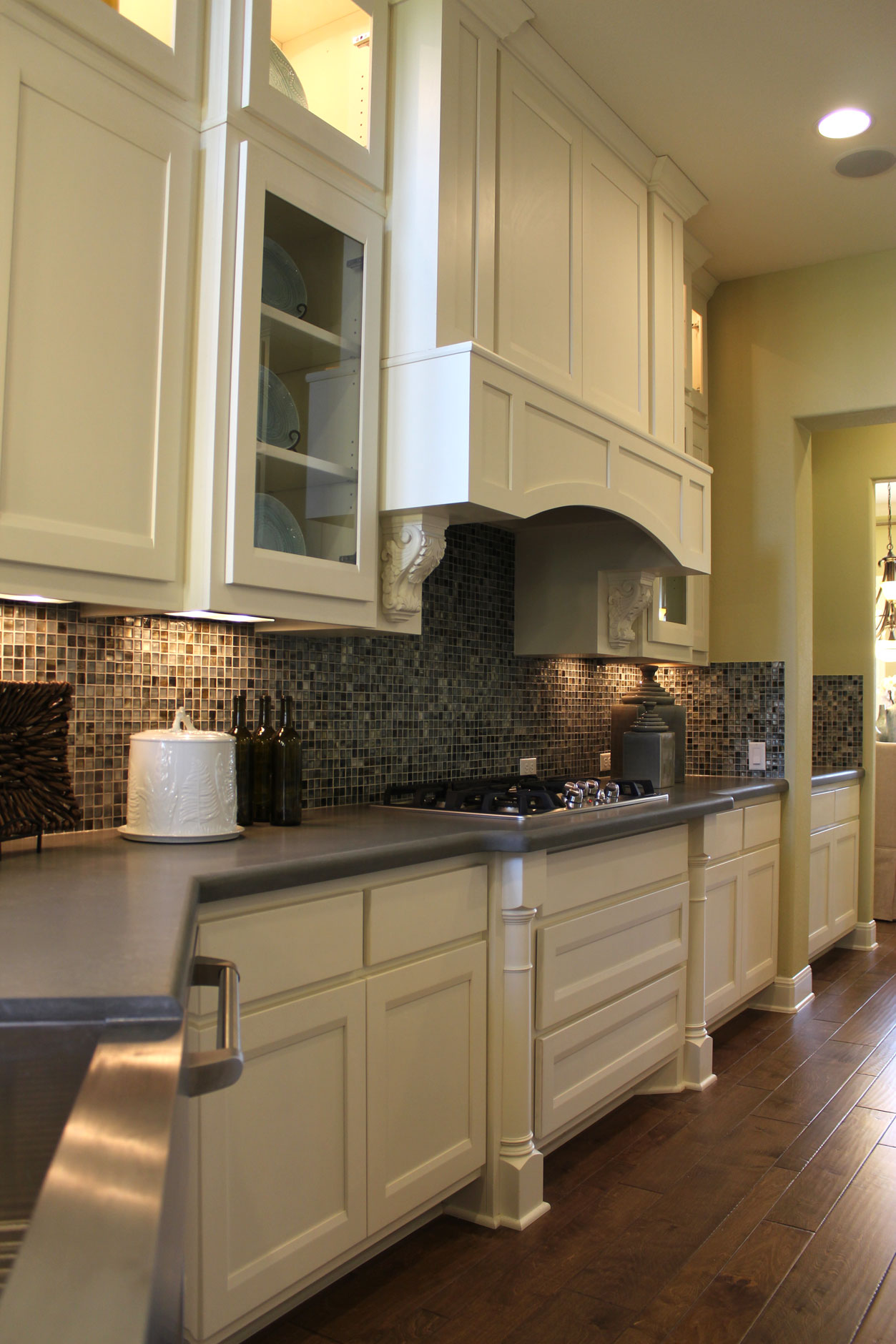 Burrows Cabinets kitchen cabinet 21 with Briscoe door style in Bone and Elite vent hood