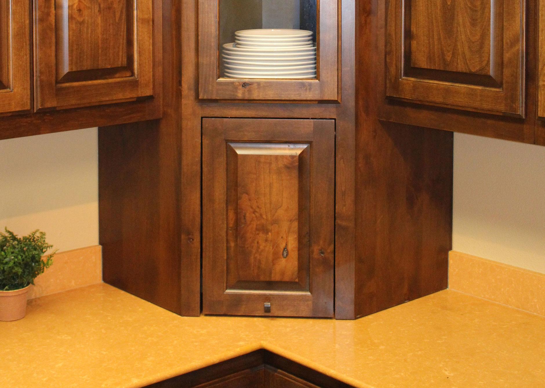 Corner appliance garage with tilt-up cabinet door