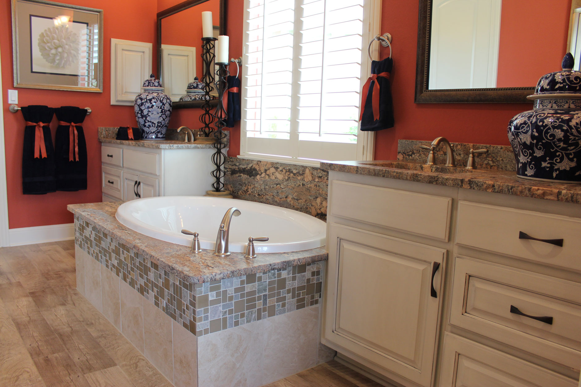 Master bath with center tub and cabinets in bone with black glaze by Burrows Cabinets