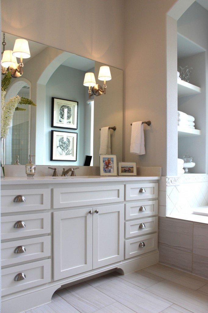 Burrows Cabinets master bath with shaker style cabinets painted white