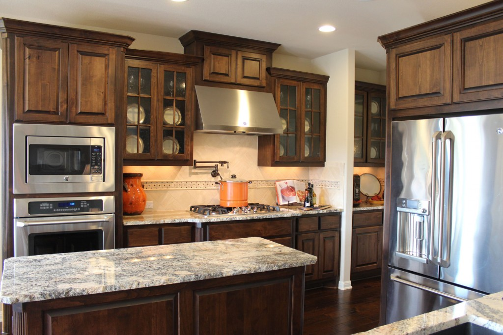 Burrows Cabinets kitchen in stained knotty alder and mullion doors with glass