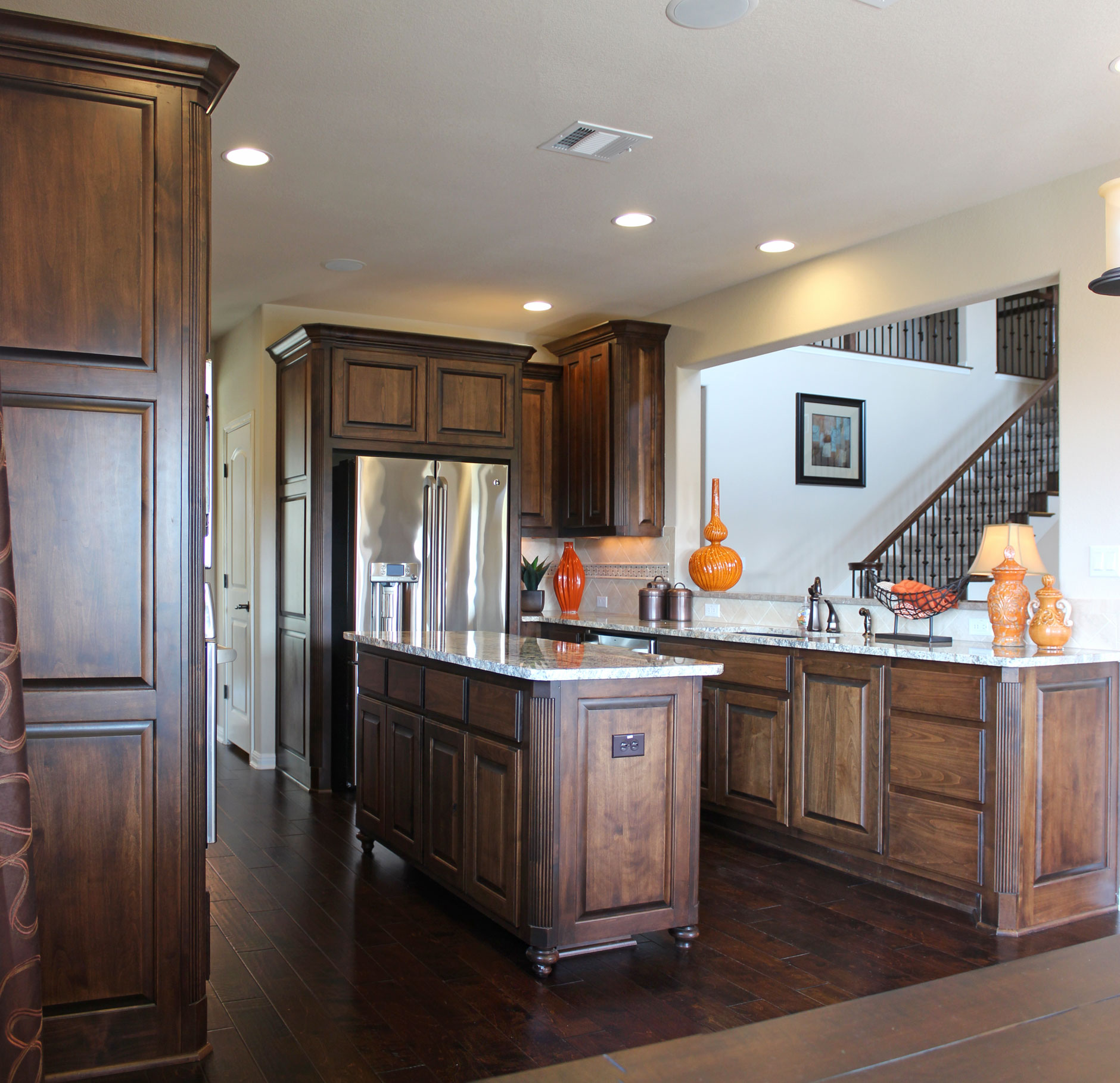 Burrows Cabinets kitchen in stained knotty alder and appliance end panels