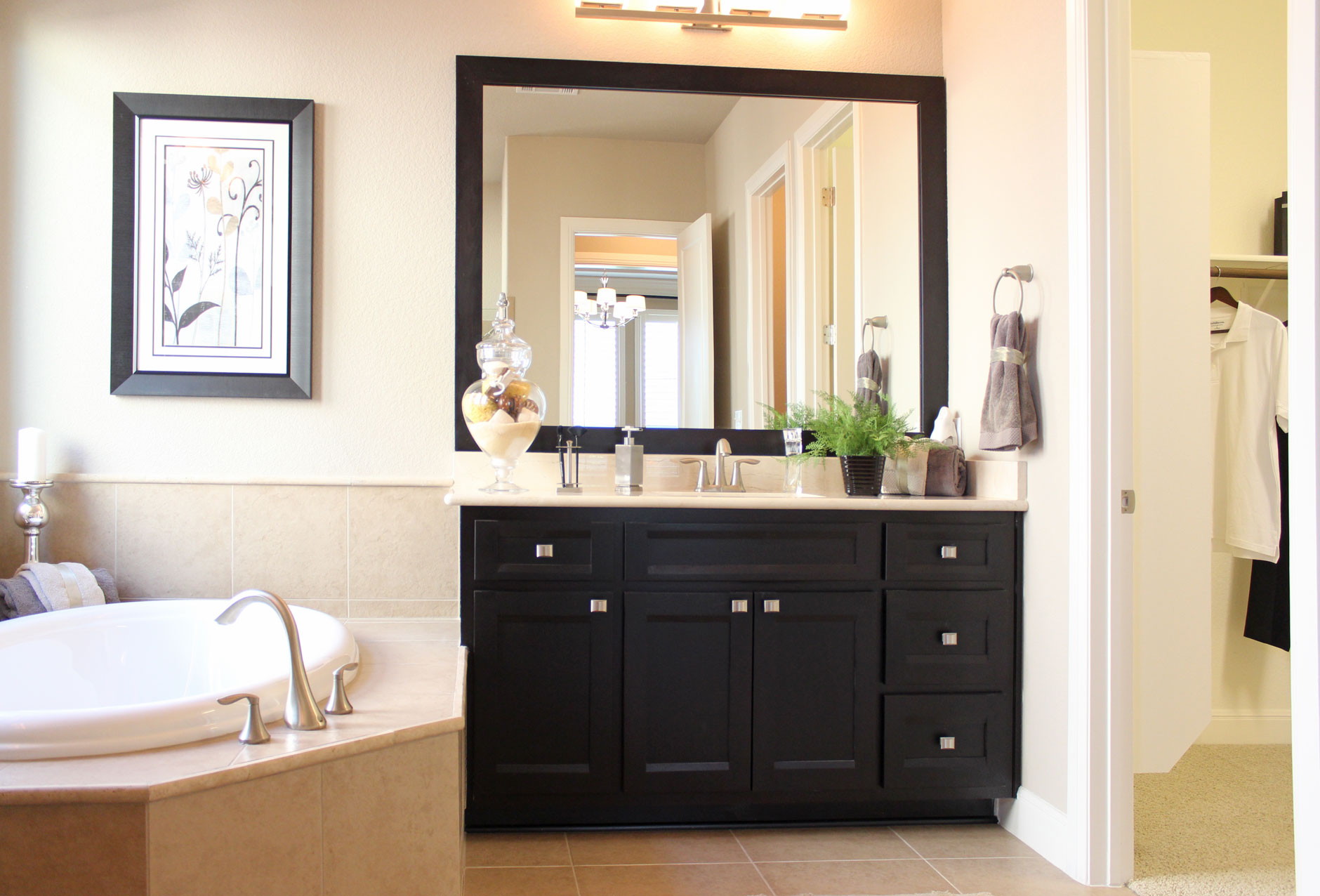 Burrows Cabinets master bath cabinets in Beech Rye with Briscoe door style