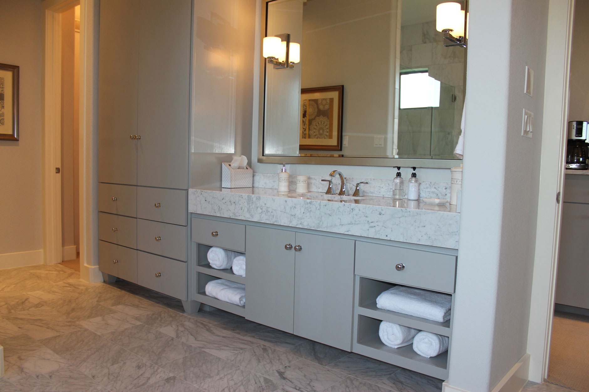 modern master bath cabinets in gray with SoCo doors and tall towel and linen storage