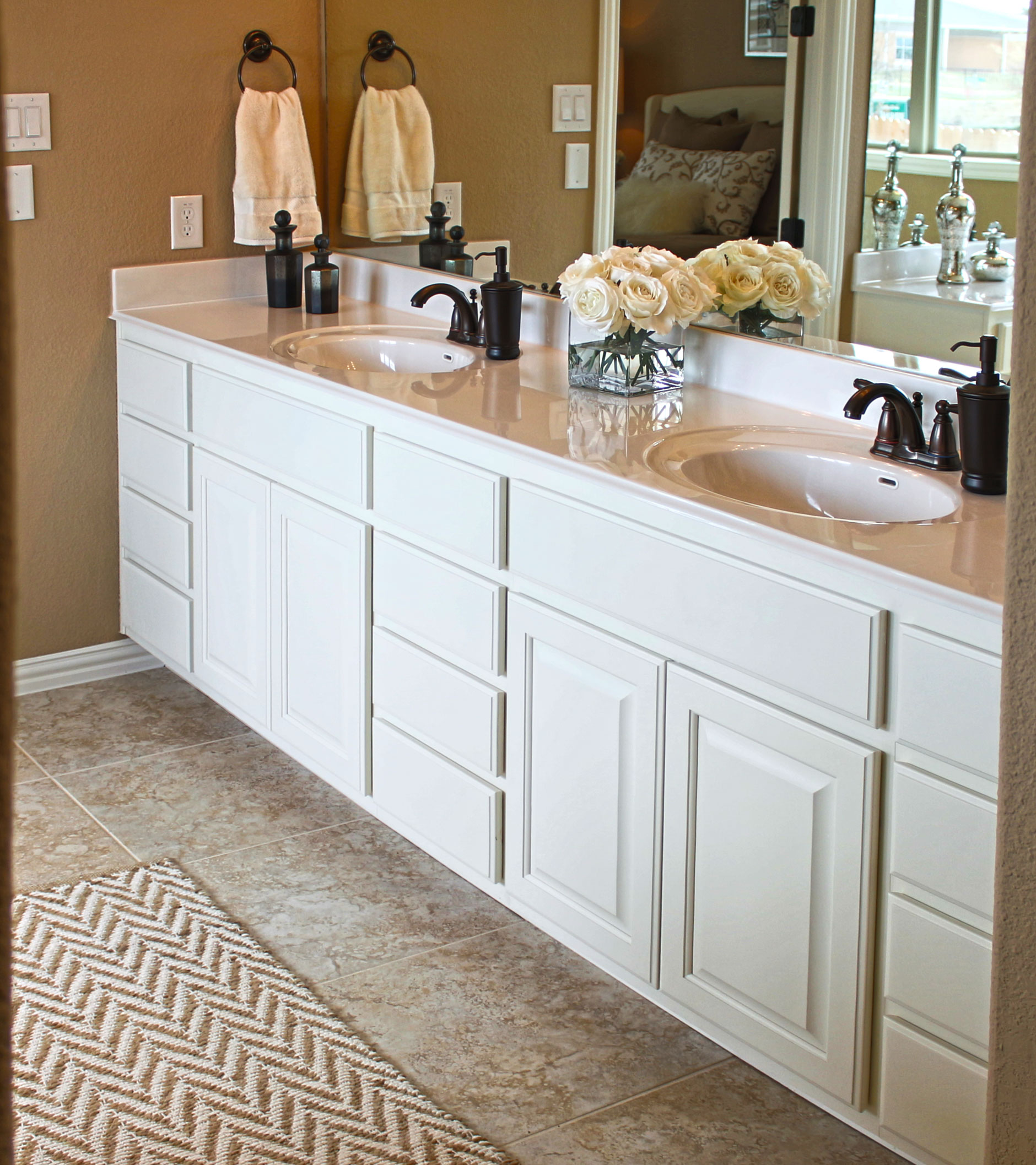 Parkside at Mayfield Ranch master bath cabinets in Bone by Burrows Cabinets