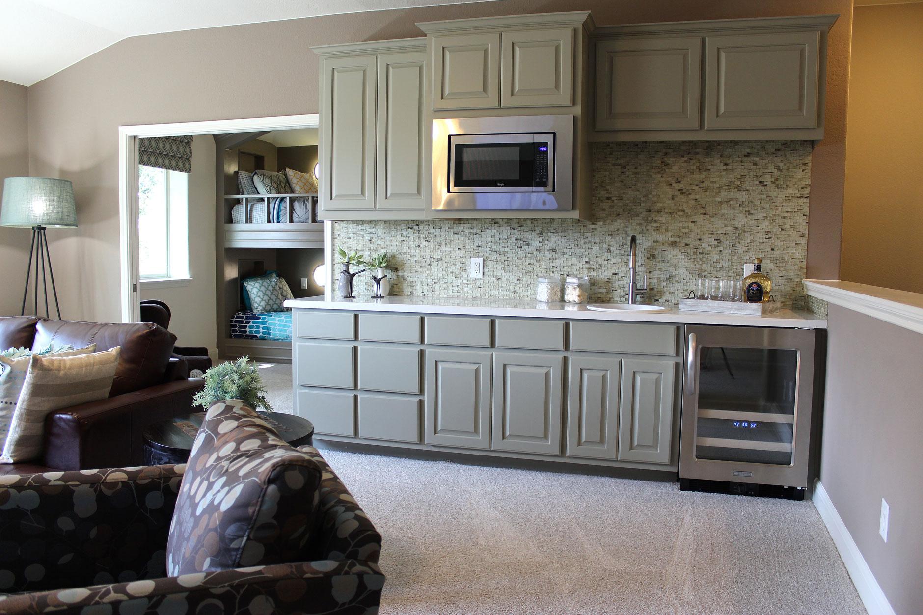 Bonus room wet bar in Ecru gray by Burrows Cabinets