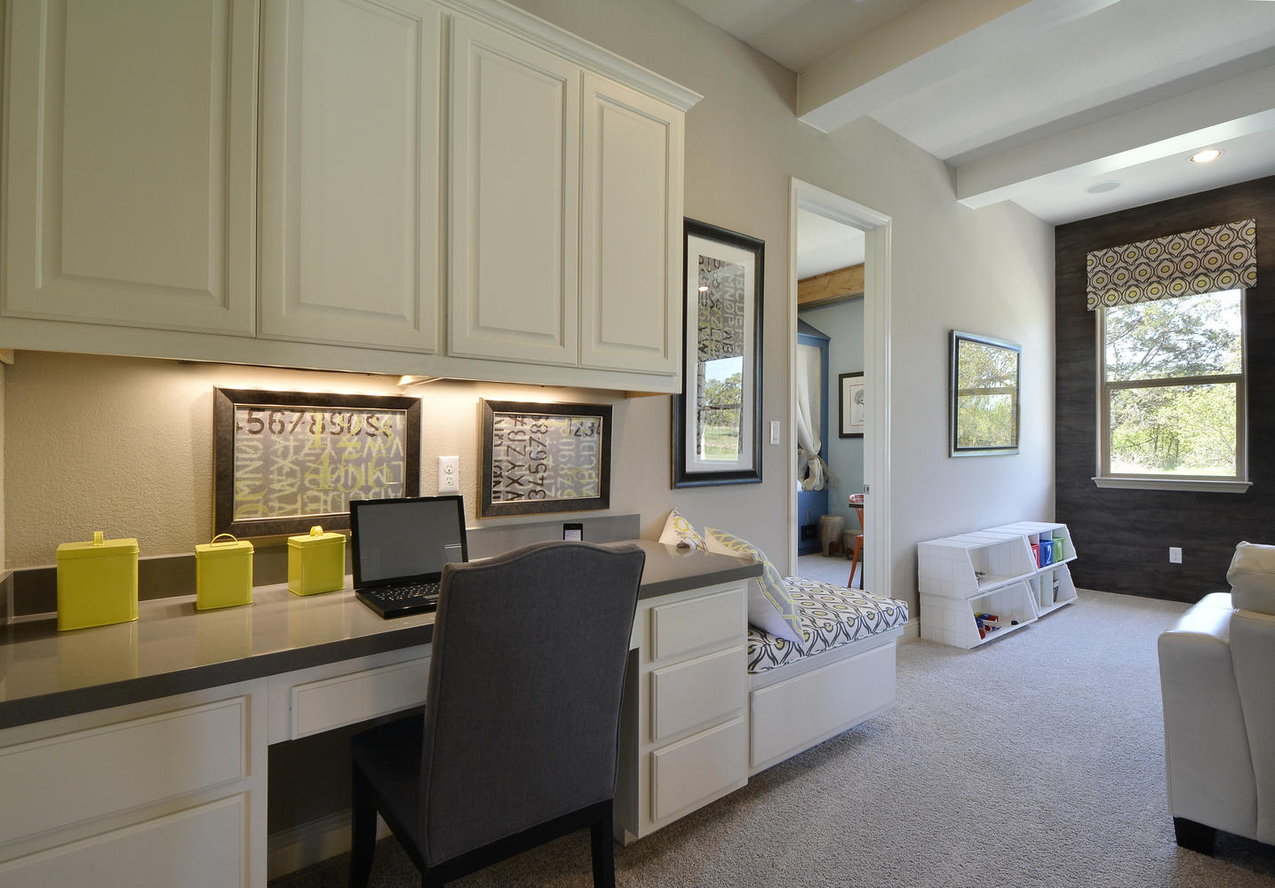 Burrows Cabinets' built in desk cabinets with bench seat in Bone white