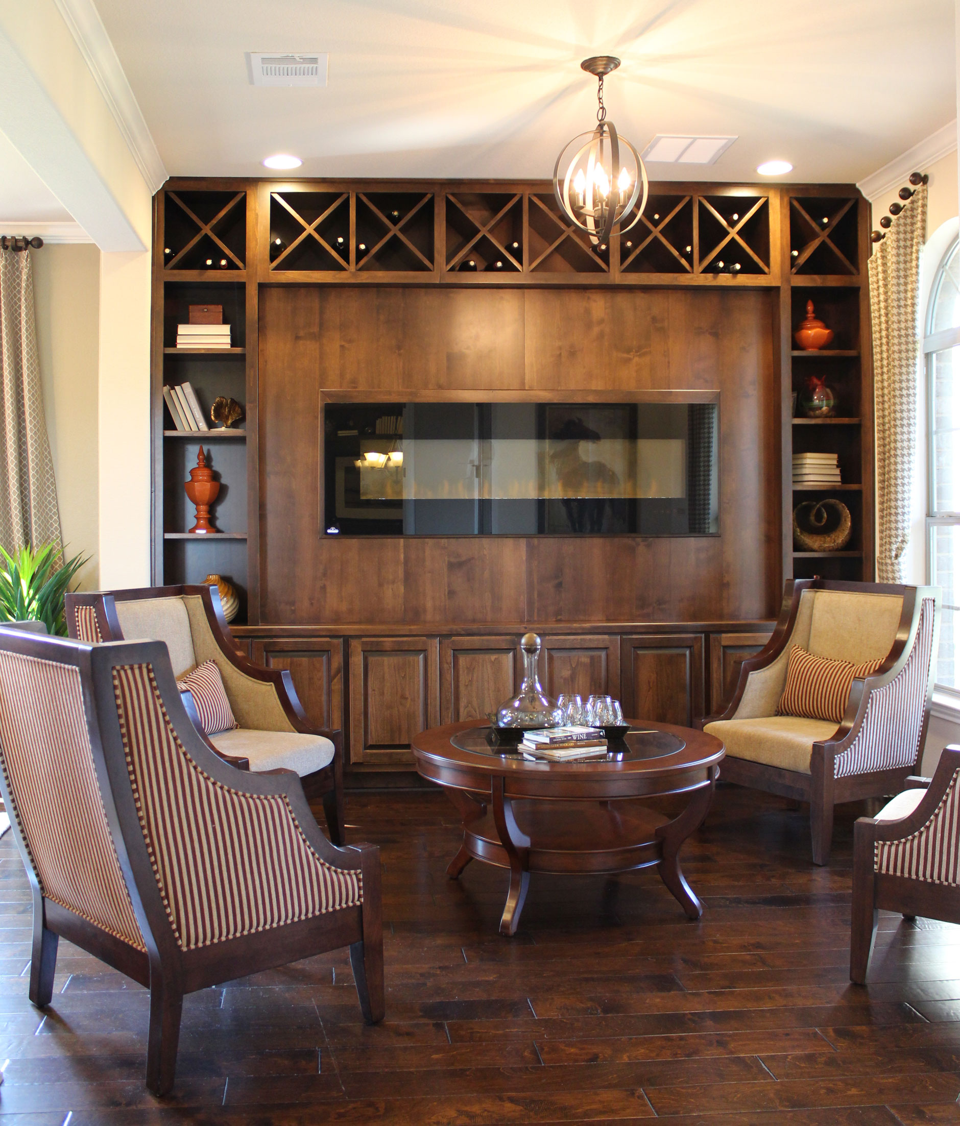 Burrows Cabinets wood fireplace surround with bookshelves in alder with verona finish
