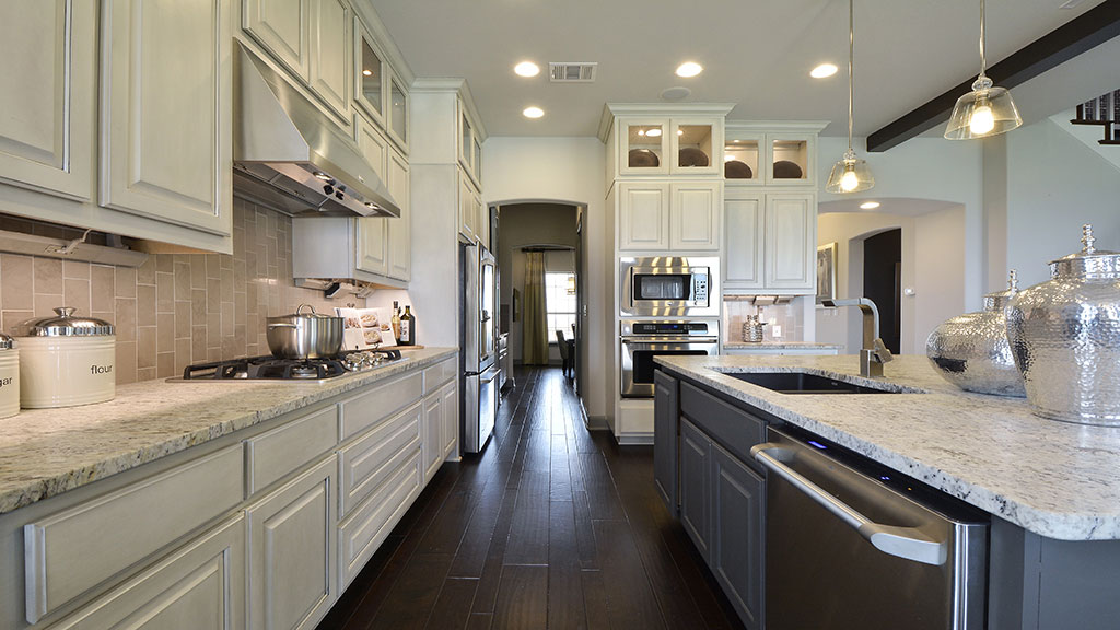 Burrows Cabinets kitchen in Bone with black glaze and Umber island