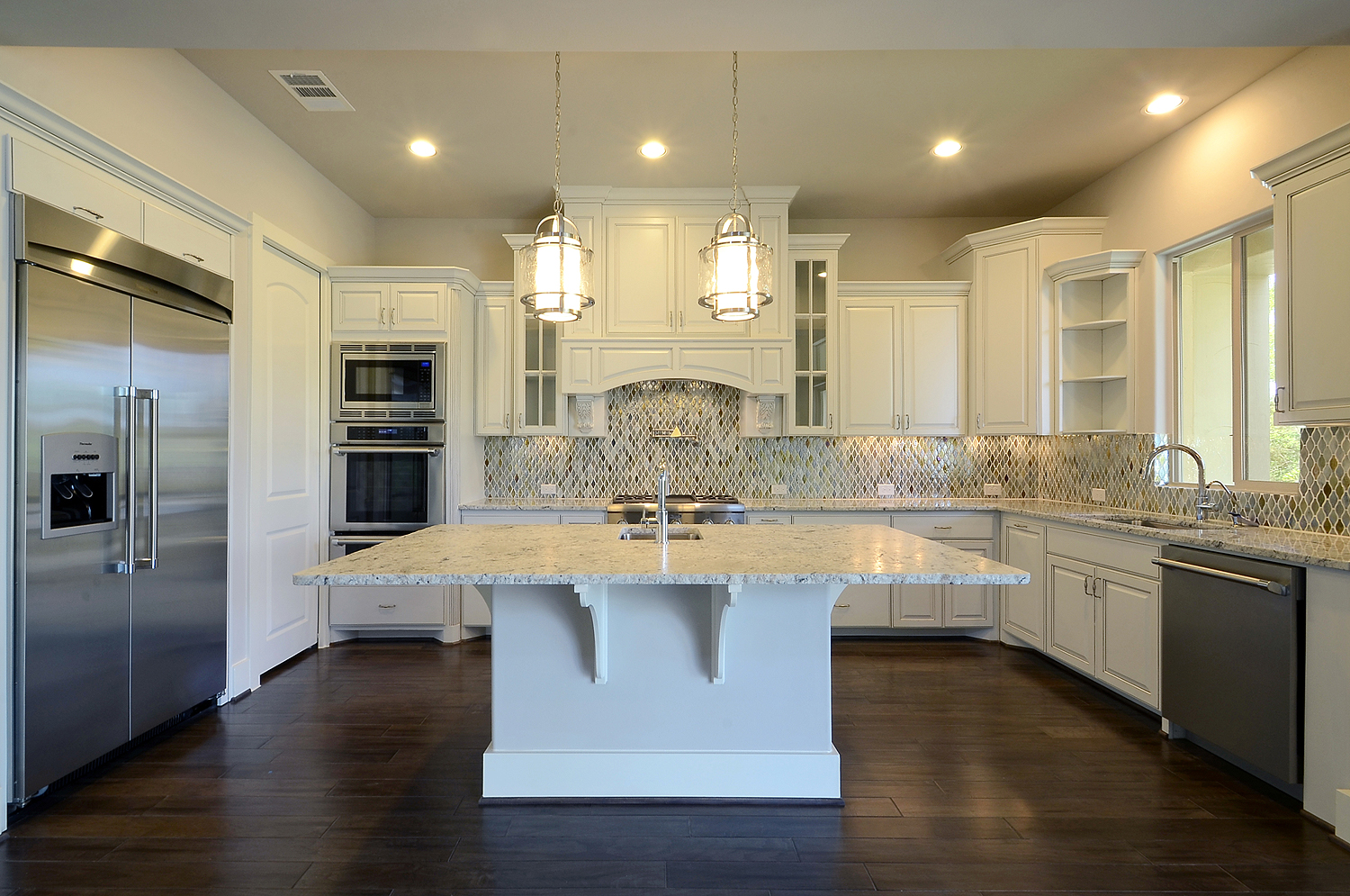 Burrows Cabinets white kitchen with glass doors, open shelves and bumped up cabinets