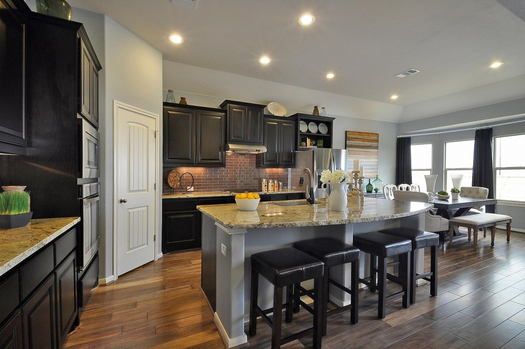 Burrows Cabinets kitchen cabinets in espresso with breakfast nook