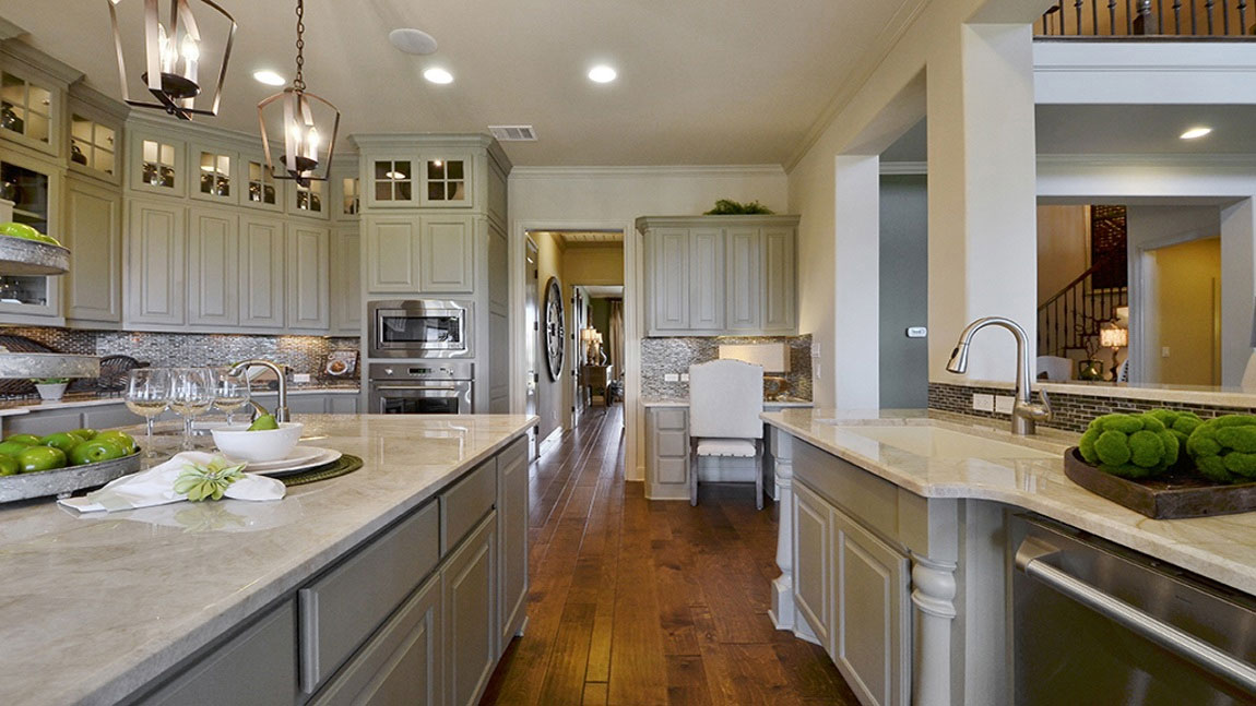 Burrows Cabinets kitchen with desk and half round sink cabinet posts in Ecru