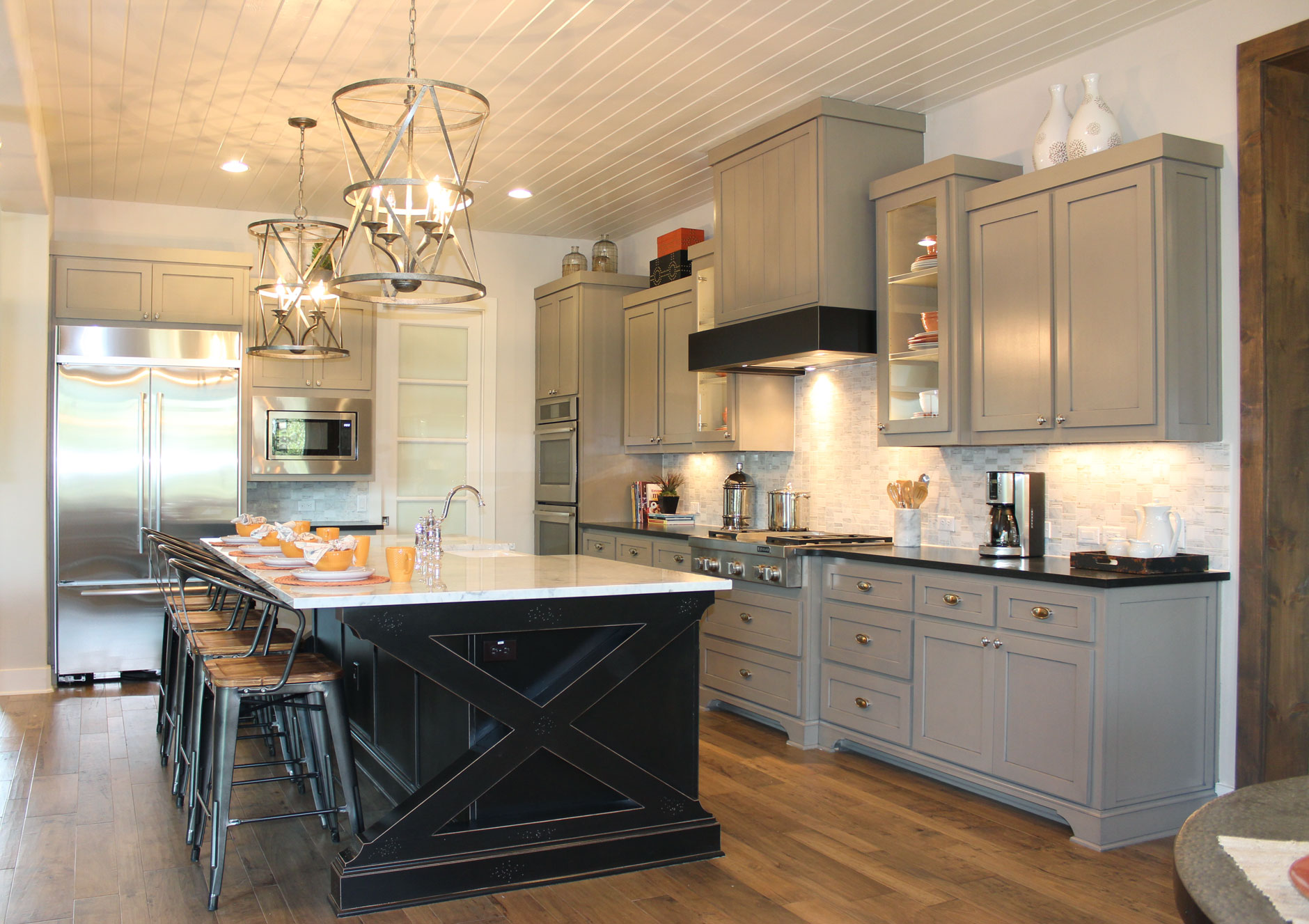 Burrows Cabinets kitchen with black island and gray wall cabinets and modern crown molding