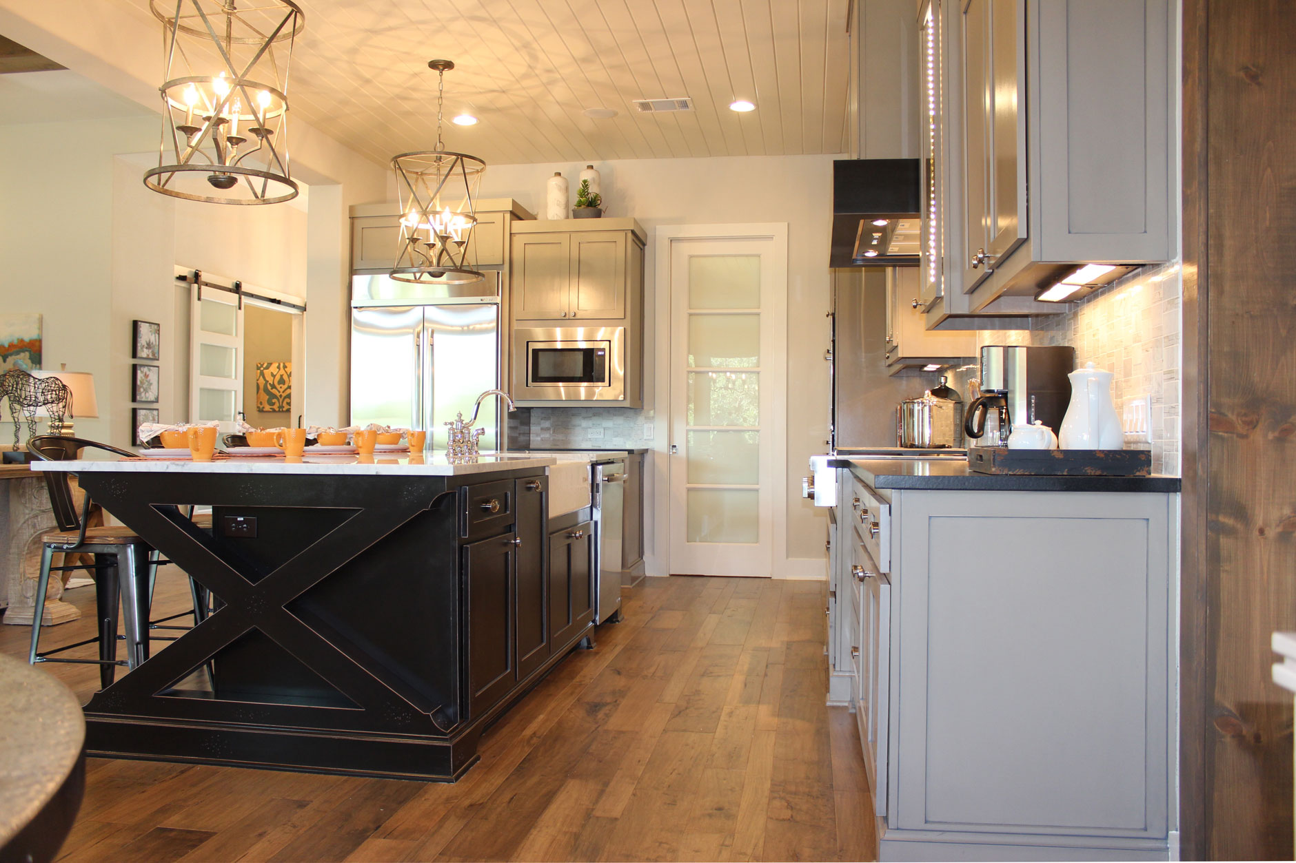 Burrows Cabinets Kitchen island with black x-brace and white farmhouse sink