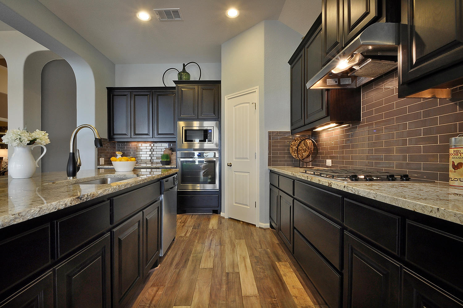 Burrows Cabinets kitchen with center island in Beech with Espresso finish