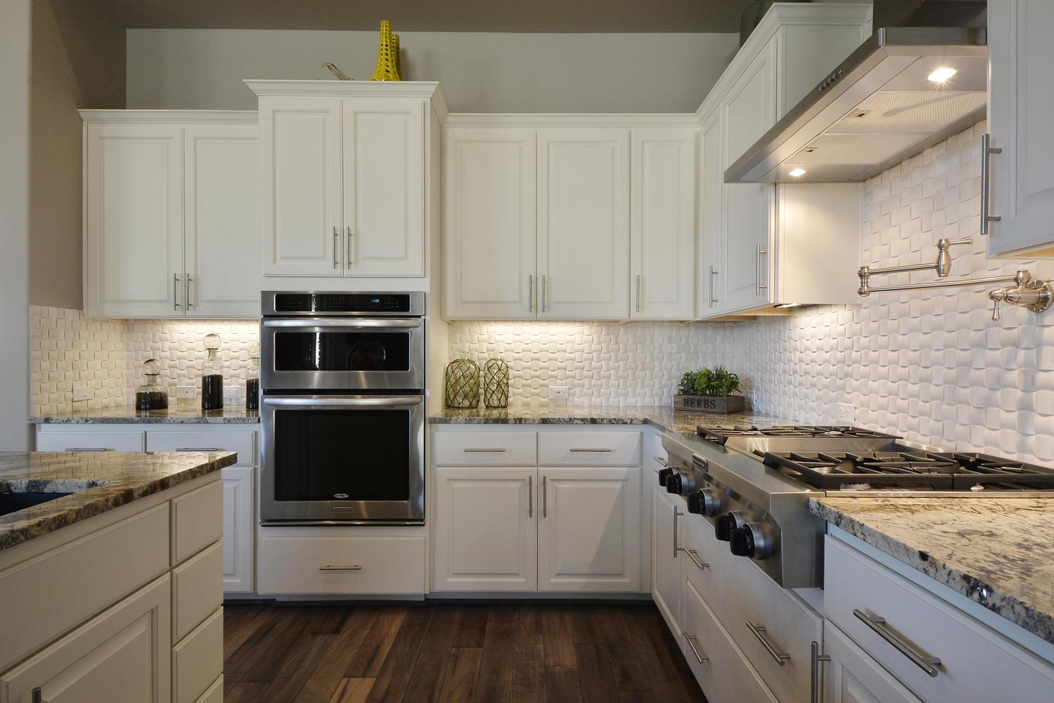 Burrows Cabinets Bone white kitchen with white subway tile