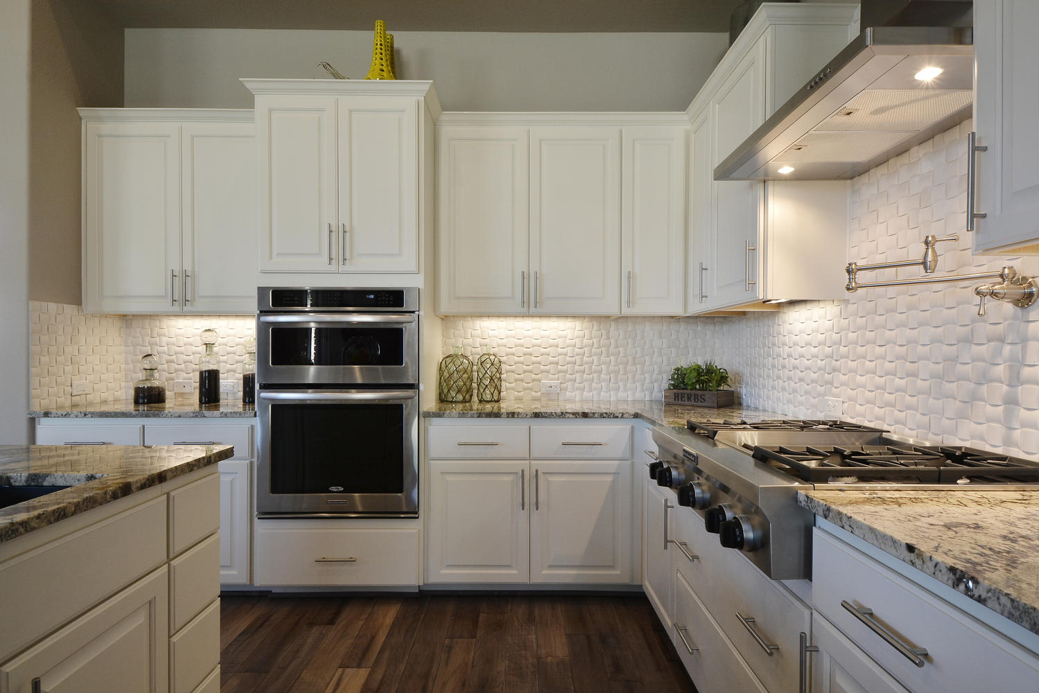 Burrows Cabinets Bone white kitchen with white subway tile