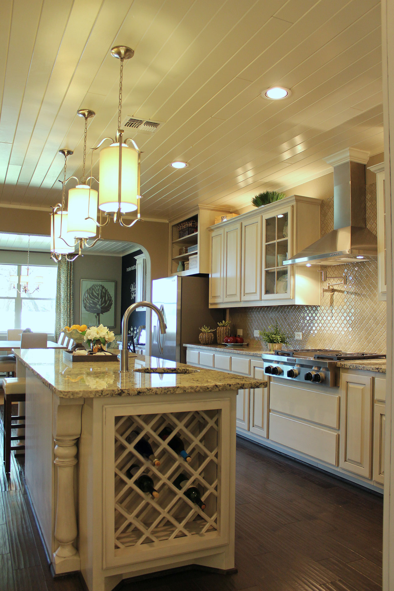 kitchen with island wine rack in bone with black glaze