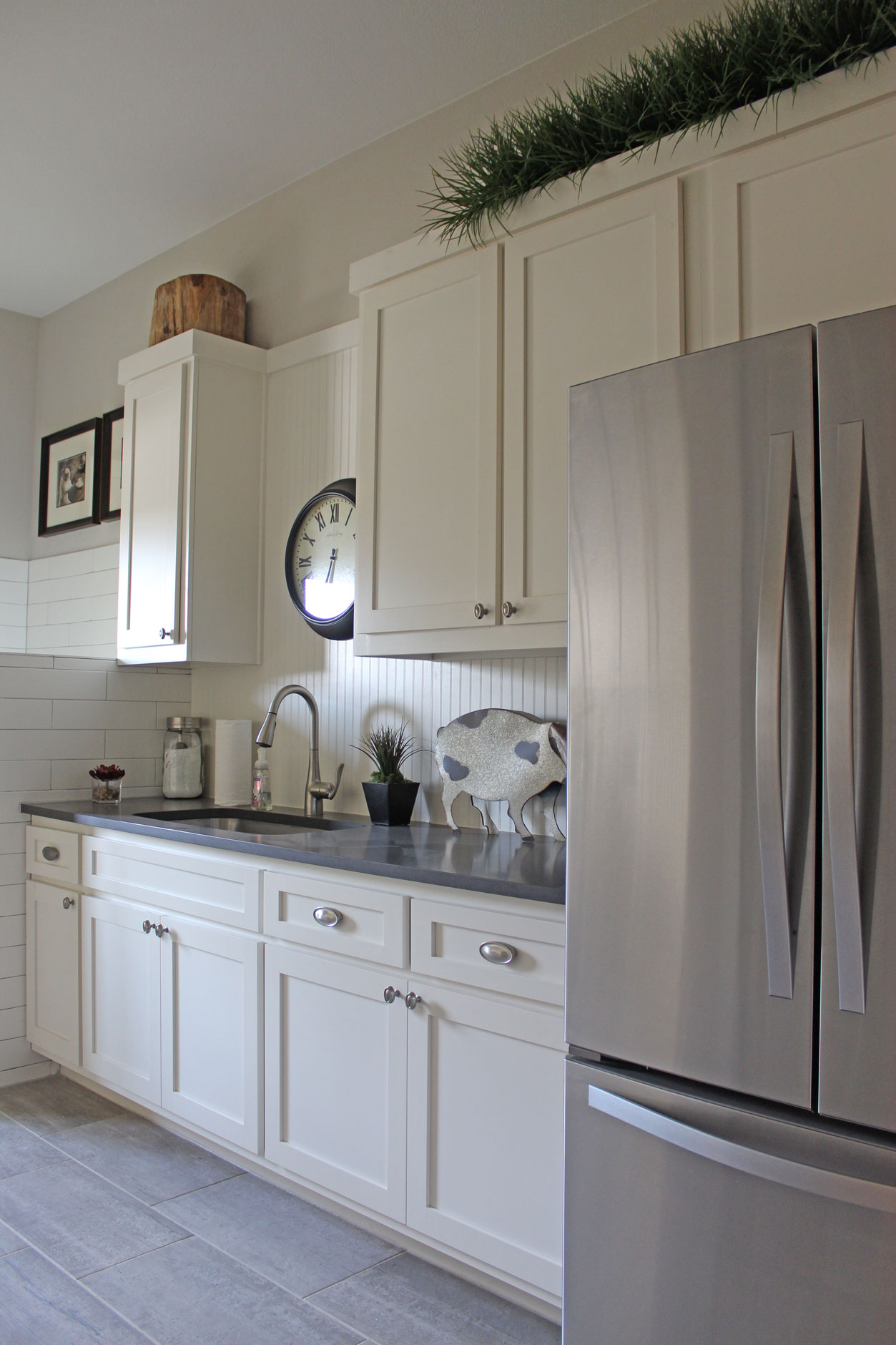 Burrows Cabinets laundry room with white beadboard backsplash
