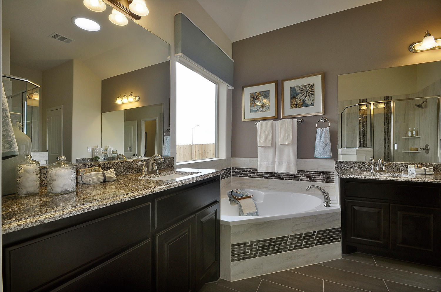 Burrows Cabinets master bath vanities in Espresso with corner tub
