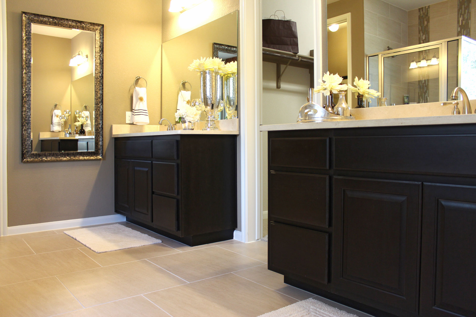 Master bath with separate vanities by Burrows Cabinets in Espresso